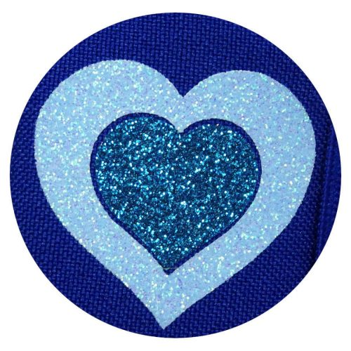 Glitter hearts on blue eye patch for glasses